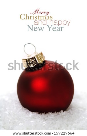 Christmas balls with snow on white  background (with easy removable sample text) - stock photo