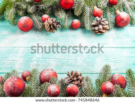 christmas banner with green tree and red ball decorations on mint wooden textured background under imitative