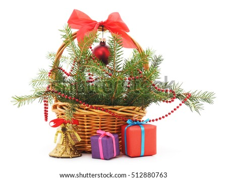Christmas basket with gifts isolated on white background.