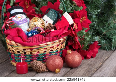 Christmas basket with ornaments in and around it - stock photo