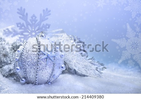 Christmas bauble on abstract winter background, text space