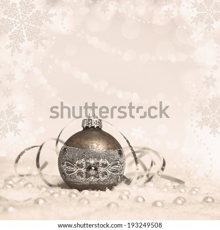 Christmas bauble on abstract winter background, text space, toned picture