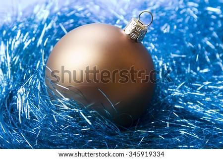 Christmas bauble on decorative angelic hair background - stock photo