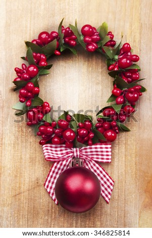Christmas bauble, rustic decoration on wood - stock photo