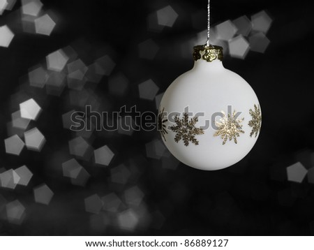 Christmas bauble with metallic ornaments in blurry back - stock photo