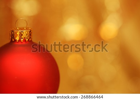 Christmas bauble with out of focus lights in background - stock photo