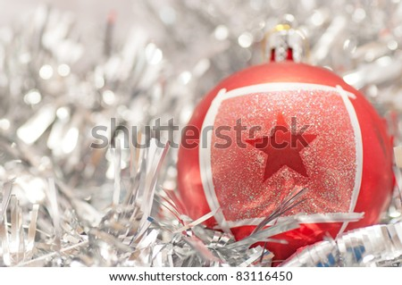 Christmas bauble with star on the silver garland - stock photo