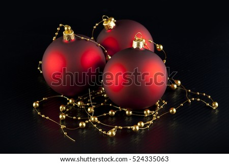 Christmas baubles and decorations on black background