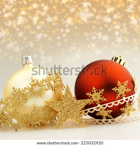 christmas baubles and decorative ribbons on starry background