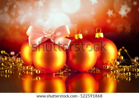 Christmas baubles and ornaments on red background