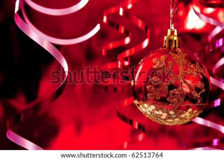 Christmas baubles and ribbons on red background - stock photo