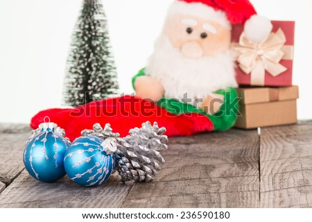 Christmas baubles and Santa Claus toy background - stock photo