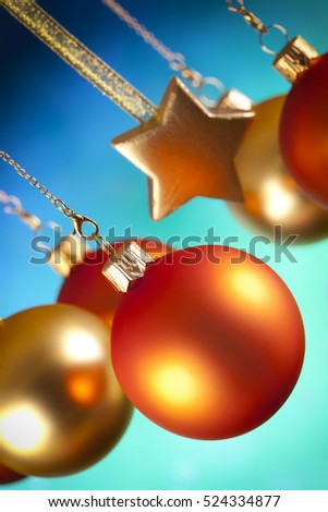 Christmas baubles and stars on blue and green background