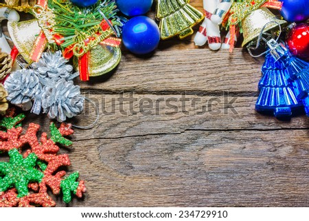Christmas baubles and vary of decoration on wood background. - stock photo