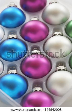 Christmas baubles in tray close-up - stock photo