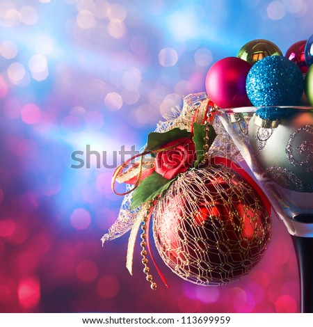 christmas baubles in wineglasses on a dark background.
