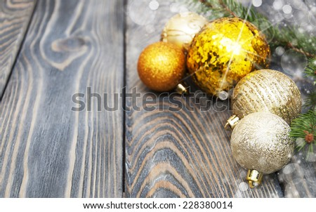christmas baubles  on a old wooden background - stock photo