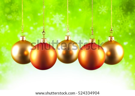 Christmas baubles on green background
