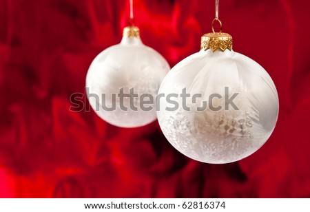 Christmas baubles on red background.Studio shot - stock photo