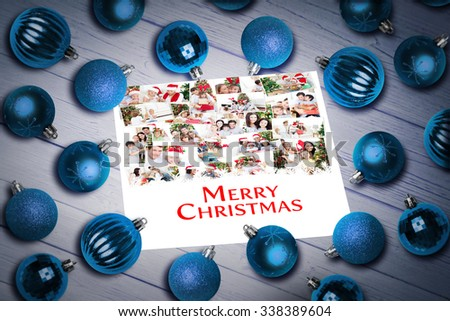 Christmas baubles on table against a happy family christmas card collage - stock photo