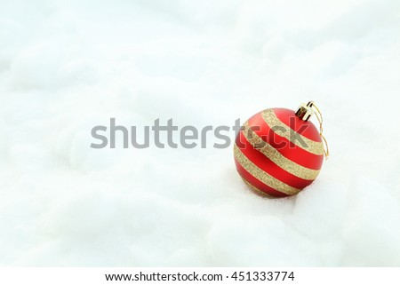 Christmas baubles on the white snow