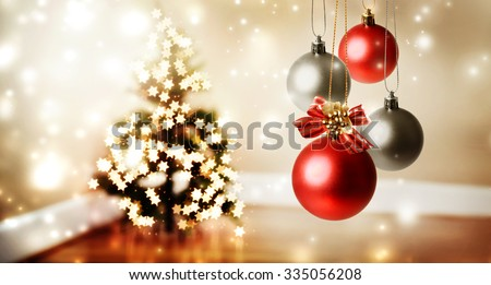Christmas baubles with star shaped lights on a Christmas tree - stock photo