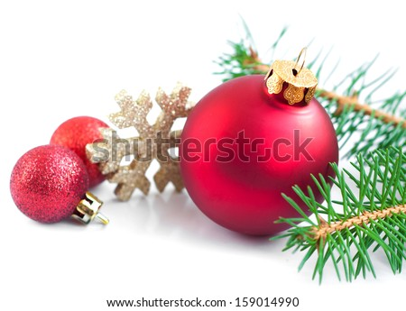 Christmas Baubles with  tree branch  on a white background - stock photo