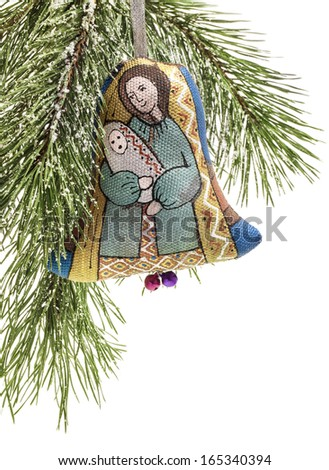 "Christmas bell, Handmade decoration, Ukrainian souvenir. Small bell ""The Nativity Play. St. Mary and Baby Jesus"" represented on this bell - stock photo"
