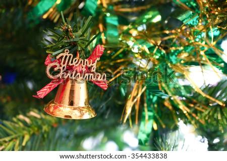 Christmas bell on tree. Christmas bell. Christmas background. Christmas bell and abstract background. Merry Christmas. Celebration background. December holiday background. Winter holiday background. - stock photo