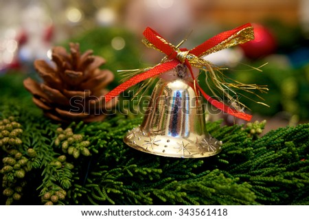 Christmas bell with pine cone on christmas background - stock photo