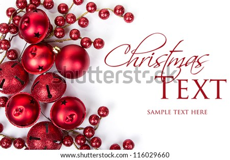 Christmas bells, ornaments and berries on white background