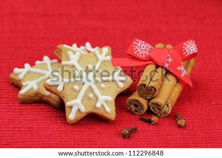 Christmas biscuits. Festive cookies decorated with royal frosting and cinnamon stick and cloves - stock photo
