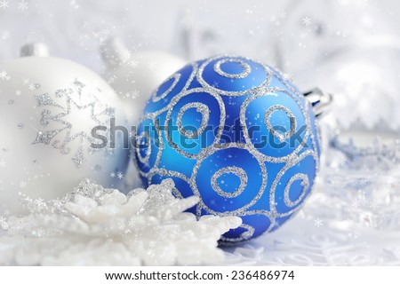 Christmas blue and silver decorations on festive background - stock photo