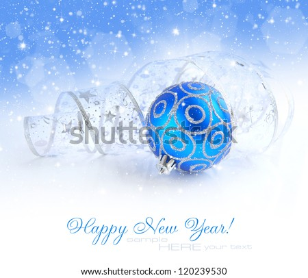 Christmas blue and silver decorations on festive background with sample text - stock photo