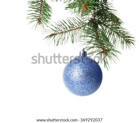 Christmas blue bauble on a fir branch, isolated on white