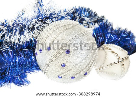 Christmas blue tinsel and blue with white glitter balls isolated - stock photo
