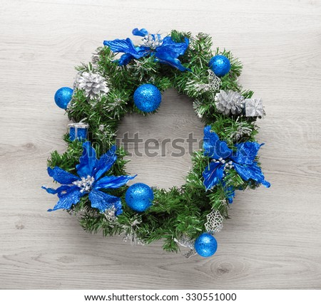 Christmas blue wreath on wood. - stock photo
