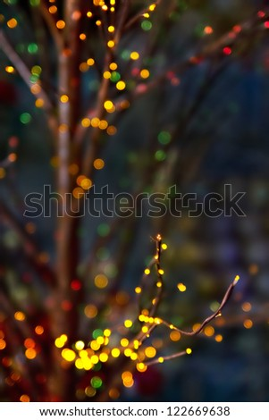 Christmas blur (bokeh lights) on the dark background with branches - stock photo