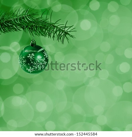 Christmas bokeh background with balls on ribbon and festive, holiday card