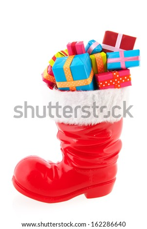 Christmas boot full with presents isolated over white background - stock photo
