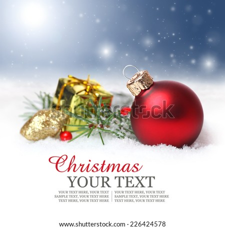 Christmas border background with red ornament, golden present, fir and snowflakes falling from the sky