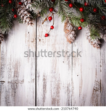 Christmas border design with snow covered pinecones - stock photo