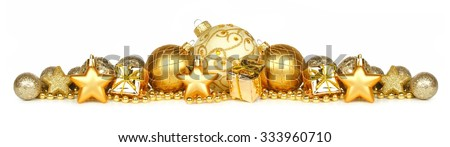 Christmas border of gold ornaments, presents and beads isolated on a white background - stock photo