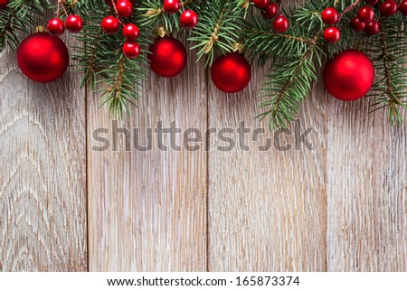 Christmas border on wooden background - stock photo