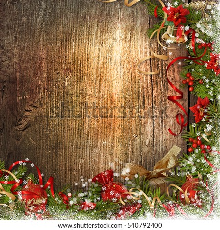 Christmas border with bell, holly, poinsettia on wood