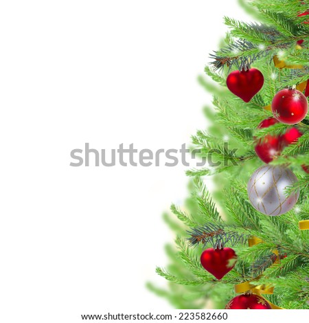 christmas border  with decorated fir tree twigs on white - stock photo