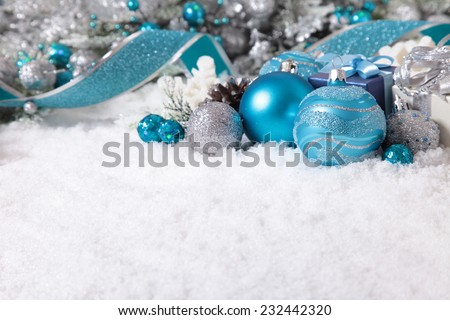 Christmas border with decorations and gifts on the snow. Space for copy. - stock photo
