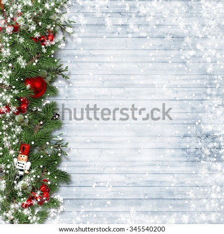 Christmas border with holly and nutcracker on vintage wood. - stock photo