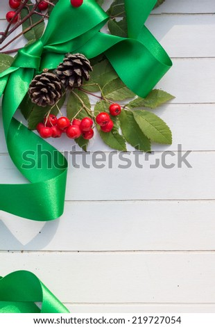Christmas Bow and Berries - stock photo