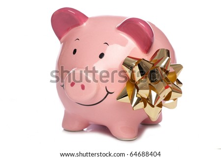 Christmas bow and Piggybank studio cutout - stock photo